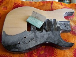 sanding guitar