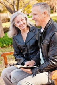 happy-couple-at-a-park-reading-the-bible-together-15215890